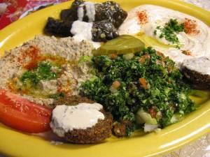 (clockwise): dolmas, hummus, tabouli, falafel, babaghanoush